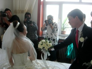 Jimmy had to answer questions from the brides maids and then give flowers to Jiao Jiao