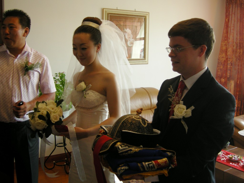 Jimmy is given Mongolian wedding clothes by the Bai's
