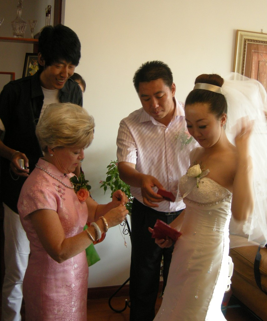 Cary gives Jiao Jiao jewelery