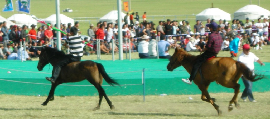 The rider in the rear is catching up to take the baton from the lead horse