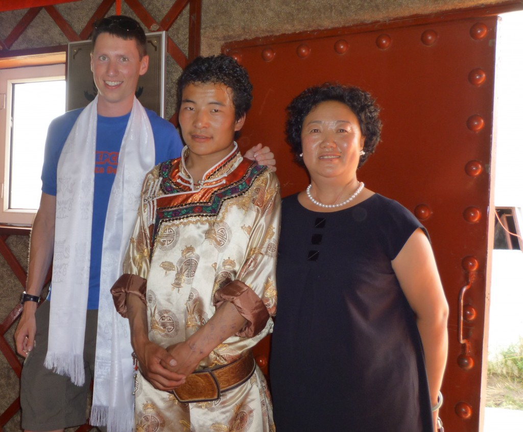 Adam, a Mongolian, and Mrs. Bai at our grass lands introduction