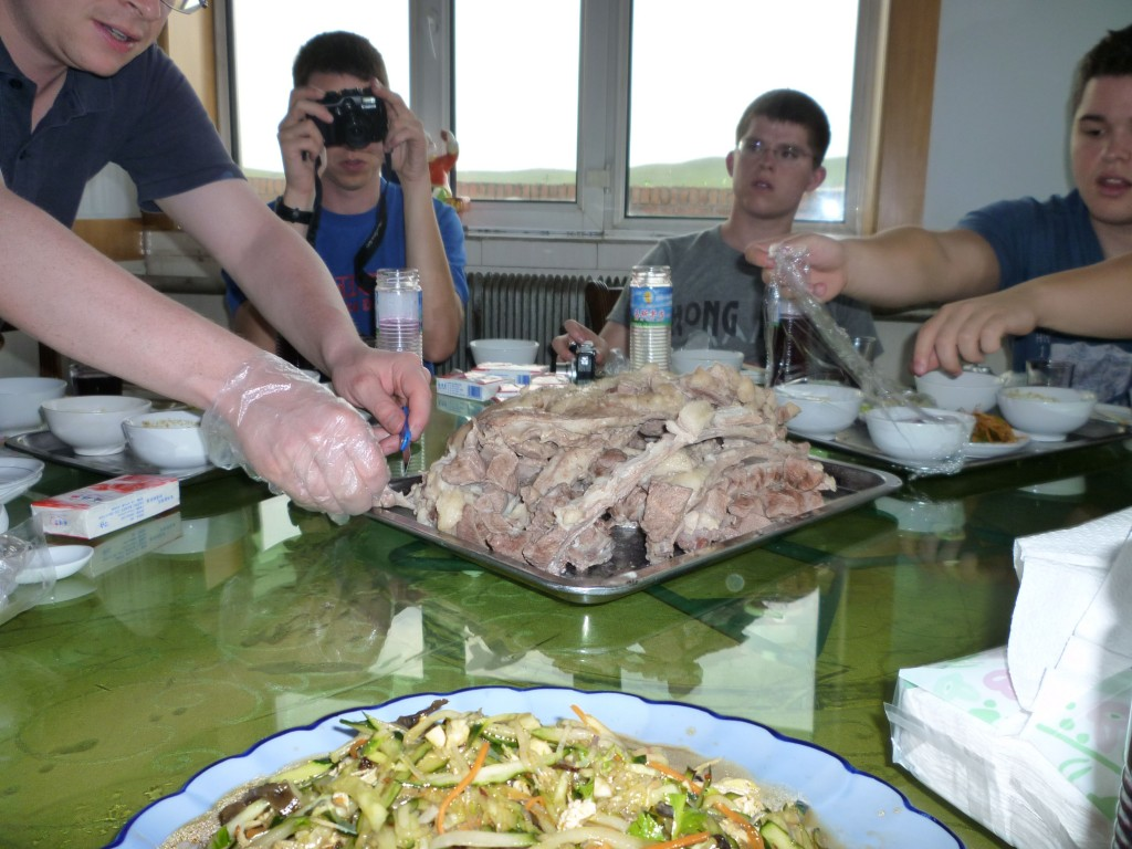 Jimmy shows us how to eat boiled Mongolian lamb