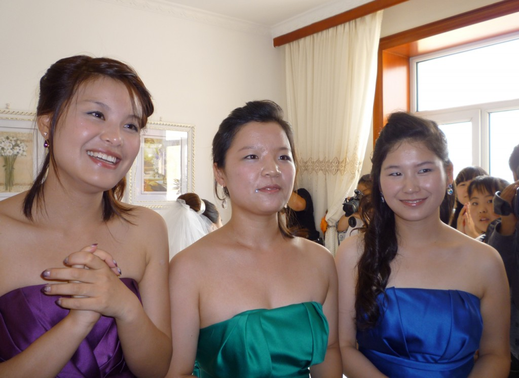 The bridesmaids stand between Jimmy and Jiao Jiao