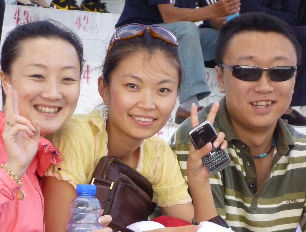 Jiao Jiao, Song Song and his girl friend watch the wrestling from the stands
